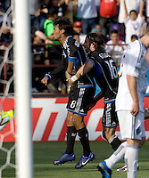 Chris Wondolowski of Earthquakes celebrates with Alan Gordon after Wondolowski scores a goal during the second half of the game against Whitecaps at Buck Shaw Stadium in Santa Clara, California on April 7th, 2012.  San Jose Earthquakes defeated Vancouver Whitecaps, 3-1.