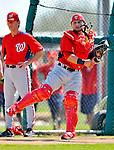 24 February 2012: Washington Nationals' catcher Jhonatan Solano takes pick-off drills at the Carl Barger Baseball Complex in Viera, Florida. Mandatory Credit: Ed Wolfstein Photo