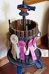 Award ribbons are displayed on an old, small wine press in the foyer at Horton Vineyards.