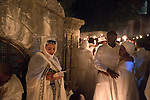 Orthodox-Ethiopian Christian pilgrims at Deir Al-Sultan, the Ethiopian section of the Church of Holy Sepulchre in Jerusalem's old city, during the Holy Fire ceremony as part of Easter. The ancient fire ritual celebrates the Messiah's resurrection after being crucified on the cross.