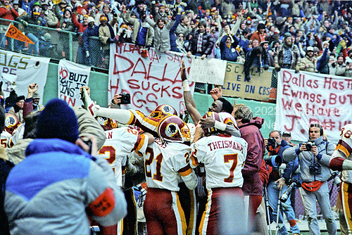 Washington Redskins wide receiver Charlie Brown (87) is carried by his teammates as they celebrate the 10 yars interception return for a touchdown by defensive tackle Darryl Grant (77) in the fourth quarter of the National Football Conference (NFC) Championship Game against the Dallas Cowboys at RFK Stadium in Washington, D.C. on Saturday, January 22, 1983.  Recognizable with brown are kick return specialist Mike Nelms (21) and quarterback Joe Theismann (7).  The Redskins won the game and the championship 31 - 17.<br /> Credit: Arnie Sachs / CNP
