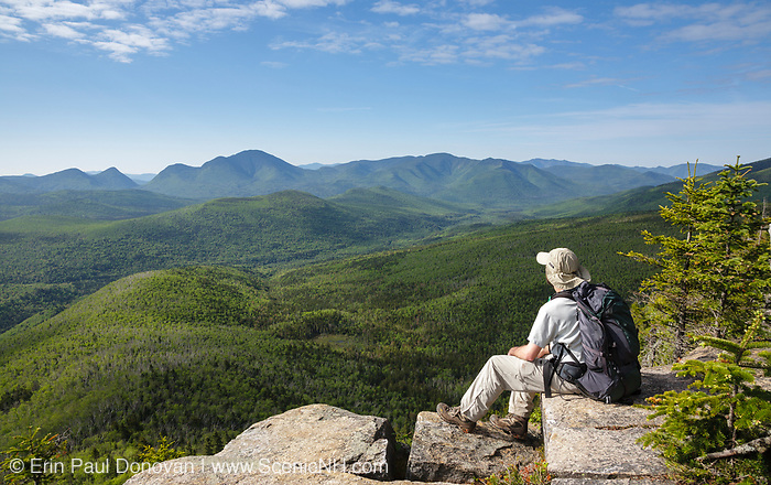 Zealand Notch  - A hiker takes in the view of the Pemigewasset Wilderness from the summit of Zeacliff during the summer months. Located along the Appalachian Trail in the White Mountains, New Hampshire USA.