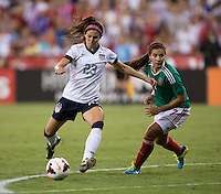 Erika Tymrak (23) of the USWNT sprints past Nayeli Rangel (7) of Mexico during an international friendly at RFK Stadium in Washington, DC.  The USWNT defeated Mexico, 7-0.