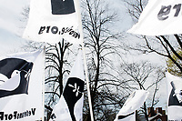 People hold Veterans for Peace flags in Cambridge Common during a Tax Day protest near Harvard Square in Cambridge, Mass., on Sat., April 15, 2017. The demonstrators called for President Donald Trump to release his tax returns. Trump refused to release his tax returns during the 2016 presidential campaign, in contrast to all previous major party presidential candidates, and continues to refuse to release them. The protest was part of a larger movement nationwide called Tax March.