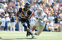 Isi Sofele carries the ball against Marshall Congdon. The University of California Berkeley Golden Bears defeated the UC Davis Aggies 52-3 in their home opener at Memorial Stadium in Berkeley, California on September 4th, 2010.