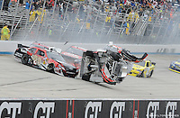 Joey Logano (20) and Clint Bowyer wreck coming to the white flag of the 5-Hour Energy 200 at Dover International Speedway