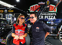 Apr 22, 2017; Baytown, TX, USA; NHRA top fuel driver Leah Pritchett (left) talks with sponsor, Papa Johns Pizza founder John Schnatter during qualifying for the Springnationals at Royal Purple Raceway. Papa John and Pritchett will face off in a Charity Challenge at the NHRA Four Wide Nationals in Charlotte. Mandatory Credit: Mark J. Rebilas-USA TODAY Sports