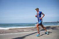 Matt Reed runs down the beach in the Accenture Ironman California 70.3 in Oceanside, CA on March 29, 2014.