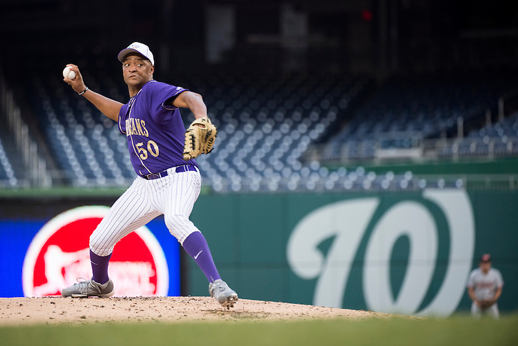 UNITED STATES - JUNE 25: Rep. Cedric Richmond, D-La., pitches at Nationals Stadium during the Roll Call Congressional Baseball Game on Wednesday, June 25, 2014. (Photo By Bill Clark/CQ Roll Call)
