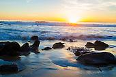 Stock photo of Sun setting at Laguna Beach