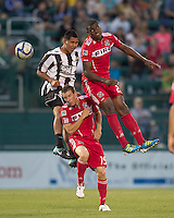 Rochester Rhinos forward Kendall Jagdeosingh (9), Chicago Fire midfielder Corben Bone (19), and Chicago Fire forward Cristian Nazarit (29) battle for head ball. In a Third Round U.S. Open Cup match, the Chicago Fire defeated the Rochester Rhinos, 1-0, at Sahlens Stadium on June 28, 2011.