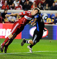 Chicago Fire forward Brian McBride (20) heads a ball toward the goal while being defended by San Jose's Steve Beitashour (33) during the first half of a match between the San Jose Earthquakes and the Chicago Fire at Toyota Park in Bridgeview, IL on April 10, 2010.  San Jose Earthquakes 2, Chicago Fire 1.