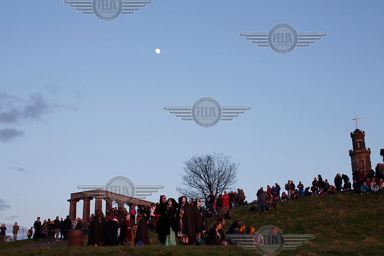 People gather near the National and Nelson Monuments on Carlton Hill in Edinburgh to celebrate hte annual Beltane Fire Festival. <br /> The Beltane Festival is an annual event when winter is purged by fire. From sunset on 30 April until early morning, over 300 volunteers create a dramatic reimagining of pagan gaelic folklore surrounded by a crowd of 6000 people. The May Queen arises to herald summer through a battle between elemental forces of order and chaos reaching a climax in the death of the green man in his winter form before bringing him back to life.