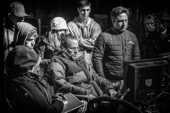"""Behind the scenes with Director Cary Fukunaga (center) watching the monitors on the set of HBO's """"True Detective"""""""