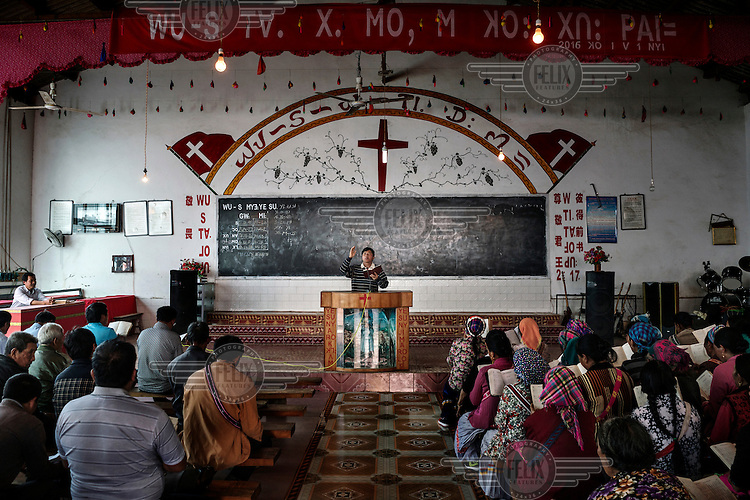 Lisu villagers attend a service at the Lawu Church on the bank of the Nujiang River.