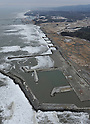 February 26, 2012, Fukushima, Japan - The remains of the tsunami-stricken town of Tomioka, Fukushima Prefecture, front, near the Fukushima No. 1 Nuclear Power Plant appear almost as vacant land in this aerial photo taken from a Mainichi helicopter on Feb. 26, 2012.