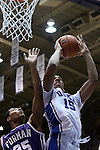 26 November 2014: Duke's Jahlil Okafor (15) and Furman's Daniel Fowler (35). The Duke University Blue Devils hosted the Furman University Paladins at Cameron Indoor Stadium in Durham, North Carolina in a 2014-16 NCAA Men's Basketball Division I game. Duke won the game 93-54.