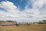 Big loop horse roping with a vast western sky at the Jordan Valley Big Loop Rodeo..
