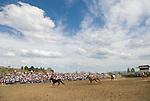 Big loop horse roping with a vast western sky at the Jordan Valley Big Loop Rodeo..