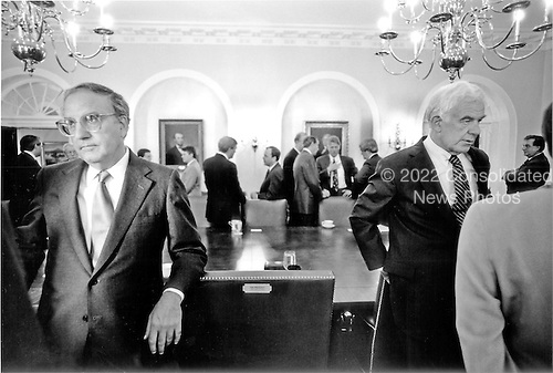 """United States Senate Majority Leader George Mitchell (Democrat of Maine), far left, and United States Speaker of the House Tom Foley (Democrat of Washington) have discussions in the Cabinet Room of the White House in Washington, D.C. on Wednesday, June 30, 1993.  In the background United States House Majority Leader Dick Gephardt (Democrat of Missouri) is speaking with White House Chief of Staff Thomas """"Mac"""" McLarty and United States President Bill Clinton is conferring with United States Senate Minority Leader Bob Dole (Republican of Kansas) and United States House Minority Leader Newt Gingrich (Republican of Georgia)..Credit: White House via CNP"""