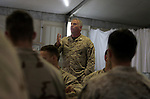 A few days before they begin the journey back to the United States after eight months in Najaf, Iraq, Marines with 1st Battalion 4th Marines listen to a talk given by the battalion's chaplain - Lt. Cmdr. Father Paul Shaunessy - on post traumatic stress and the difficulties they may face adjusting as they return home to Camp Pendelton in southern California on January 28, 2005.