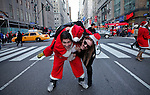 People dressed as santa claus gather in midtown as they take part during the SantaCon party in New York, United States. 15/12/2012. Photo by Kena Betancur/VIEWpress.