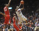 Ole Miss guard Chris Warren (12) shoots as he is defended by Georgia's Trey Tompkins (33) and Georgia's Gerald Robinson (22) at the C.M. &quot;Tad&quot; Smith Coliseum in Oxford, Miss. on Saturday, January 15, 2011. Georgia won 98-76.  (AP Photo/Oxford Eagle, Bruce Newman)