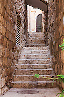 A narrow covered stone stairway in the Jewish Quarter of the Old City of Jerusalem.