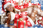 Beautiful young woman with Christmas gifts