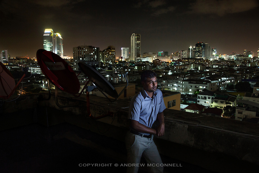 Sri Lankan refugee, Paramanantham Dhushyanthan, 31, from Mannar District, pictured in Bangkok, Thailand<br /> <br /> &quot;I was a member of a political party called EPRLF (Eelam People Revolutionary Liberation Front). I joined them to get work and I became a bus conductor, this is a government job. In the election campaign we had some problems from the government parties, they did not want us to run in the election so they always beat us and warned us not to enter the election. When I was there every day when you go to sleep you don't know if you will wake in the morning, because in my area many people were taken during the night by the military and you will not see them again. They arrive in unmarked vehicles, in Sri Lanka we call it the 'white van'. <br /> <br /> I would not stay in my home because I thought something could happen to me, I stayed in a friend's, or at my sister's. So one day I was kidnapped, it was July 10th, 2008, at 7pm. During that time there were many people kidnapped, we would see many people dead in the mornings by the roadside; the government and their parties would shoot them. That evening six people came in a vehicle, they pointed a gun at my chest and told me to get in the vehicle. They bound my hands, I recognised them, one was from Criminal Investigation Department of Sri Lanka. They took me to an open area and took me out from the vehicle and everyone started to beat me with guns, I was kneeing in front of them and one man loaded a gun and pointed it at my head and was ready to kill me. Then one man said, &quot;don't do it now let's do it later, because when we caught him there was a doctor watching us&quot;. They beat me again and left me. I went to my house and told my mother, the next day my mother took me to Columbo. <br /> <br /> I arranged some money, my sister pawned some things, and I came to Bangkok. A man told me that Bangkok is the only place that the refugees can stay, that you can register with the UNHCR and they will loo