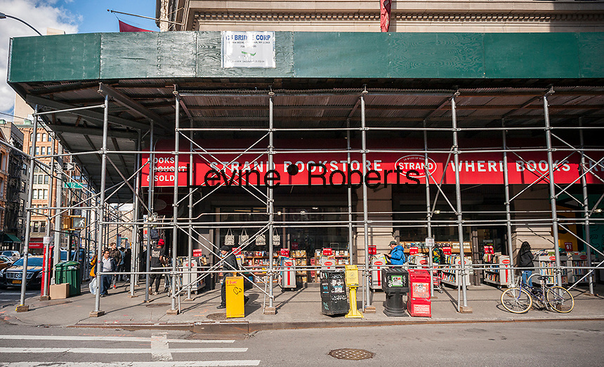 The Strand Bookstore in the New York neighborhood of Greenwich Village is covered by scaffolding, seen on Wednesday, March 8, 2017. (© Richard B. Levine)