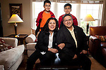 Claudia Garrido-Revilla is a Fox Trial Finder Ambassador in Peoria, Ill. She educates people about participating in clinical trials studying Parkinson's, and always carries informational materials with her. Garrido-Revilla, shown in her family room with her husband, Carlos, and their sons David, left, 10, and Carlos, right, 13, has Parkinson's herself, and is a leader of Team Fox at Peoria Academy.