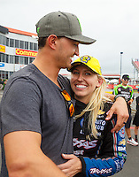 May 1, 2016; Baytown, TX, USA; NHRA funny car driver Courtney Force (right) celebrates with husband Graham Rahal after winning the Spring Nationals at Royal Purple Raceway. Mandatory Credit: Mark J. Rebilas-USA TODAY Sports