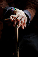 Hands of an older woman holding a walking cane at Toganji temple in Sugamo, Tokyo, Japan April 14th 2010. Sugamo is affectionately known as the old lady Harajuku, in reference to the Mecca for youth fashions in the South of Tokyo, and is a popular place for Tokyo's increasingly aged population.