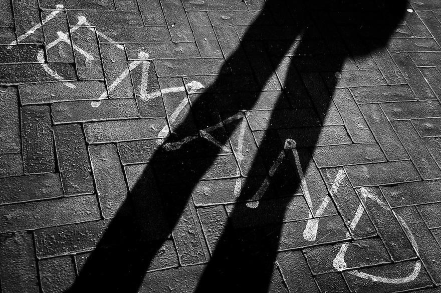 Nederland, Amsterdam, 14 maart 2013<br /> Tekst op straat: iemand.<br /> <br /> Written on the street: iemand, in english: somebody<br /> <br /> Foto(c): Michiel Wijnbergh