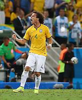 David Luiz of Brazil celebrates scoring his goal to make the score 2-0