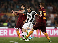Calcio, Serie A: Roma, stadio Olimpico, 14 maggio 2017.<br /> Juventus' Gonzalo Hoguain (c) in action with AS Roma's Diego Perotti (l) and Daniele De Rossi (r) during the Italian Serie A football match between AS Roma and Juventus at Rome's Olympic stadium, May 14, 2017.<br /> UPDATE IMAGES PRESS/Isabella Bonotto