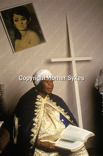 "Evangelist Hilda Steadman holds services in her east London flat where the room has been transformed into the ""Lilly of the Valley Mission"", part of the Church of God of Prophecy grouping of churches."