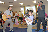 Michael Cladis and Kenny Batch entertain children during the MLK Kidz Party at Virginia Avenue park on Saturday, January 15, 2011.