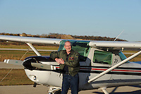 Mike Love poses with his aerobatics training plane at Morey Airplane Co. at Middleton Municipal Airport on Thursday