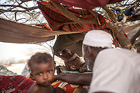 Tuesday 07 July, 2015: A displaced family from the heavy fighting in Sa'bah governorate is seen in Al Manjoorah camp, a temporary settlement at the outskirts of Beni Hassan in Hajjah province, Northwest of Yemen. (Photo/Narciso Contreras)