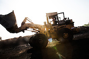 An employees of BCCL loads up coal on a train carriage in Jharia, Jharkhand, India.