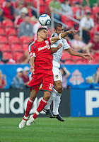 26 June 2010: Toronto FC defender Adrian Cann #12 and Los Angeles Galaxy forward Jovan Kirovski #9 jump for a ball during a game between the Los Angeles Galaxy and the Toronto FC at BMO Field in Toronto..Final score was 0-0...