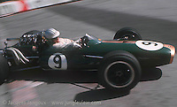 Formula One driver Denny  Hulme driving his Brabham-Repco at the Gazomètre hairpin at the Grand Prix of Monaco in 1967. Hulme throws his car in oversteer in the curve, controlling the slide by opposite lock. Hulme won the race and was World Champion in 1967.