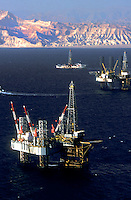 Stock photo of an aerial view of oil and gas jackup drilling rig and dynamic positioning drill ship in the Gulf of Suez with the Sinai Peninsula in Egypt