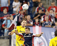 Columbus Crew defender Chad Marshall (14) and New England Revolution substitute forward Blake Brettschneider (23) battle for head ball. In a Major League Soccer (MLS) match, the New England Revolution defeated Columbus Crew, 2-0, at Gillette Stadium on September 5, 2012.