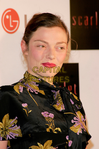 """CAMILLA RUTHERFORD .""""Scarlet"""" - TV series launch, No. 1 Marylebone, Marylebone Road, London, England..April 30th, 2008.headshot portrait black green purple floral print high collar asian style .CAP/AH.©Adam Houghton/Capital Pictures."""