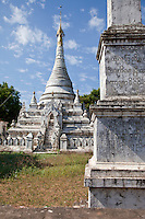 Myanmar, Burma.  Mingun, near Mandalay.  Bhuddist Stupa.  Unlike a temple, a stupa is solid, with no room inside to enter.  The protective, umbrella-like covering at the top is called a hti.
