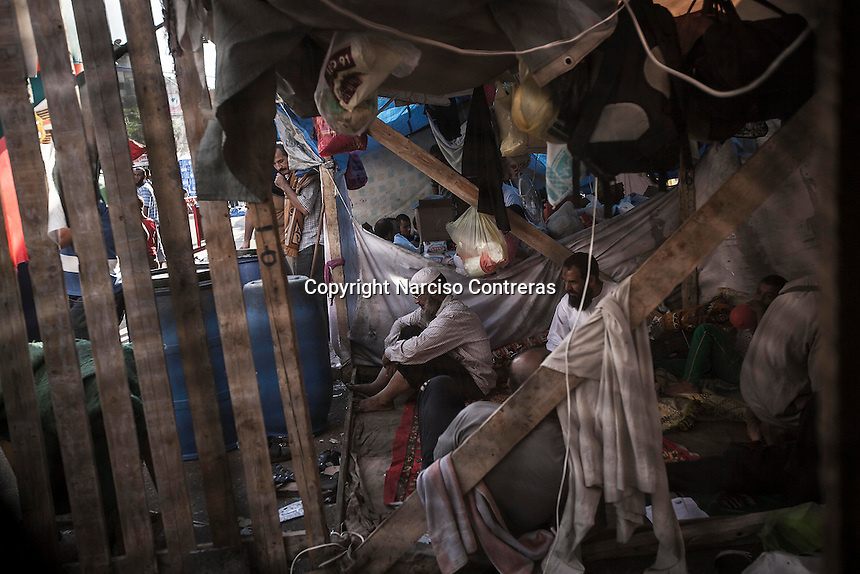 In this Friday, Aug. 09, 2013 photo, supporters of the ousted president Mohammed Morsi are seen inside a tent in the sit-in at streets nearby Al-Raba'a Alawya mosque in the Nasr district of Cairo. (Photo/Narciso Contreras).