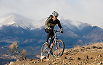 """Salida resident Eric Tauer breaks away from work for a lunchtime ride up """"Li'l Rattler"""" a new single track trail for hikers and mountain bikers on the outskirts of town. In the background is the Sawatch mountain range. Michael Brands for The New York Times."""